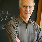 David Gross in his office which is also his lab. He is also seen around his Physics building and on campus at the University of California, Santa Barbara.