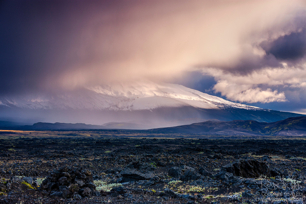 The summit of Hekla, one of the most active volcanoes in Iceland, is obscured by storm clouds just before sunset. The volcano, located in south Iceland, has a height of 1,491 meters (4,892 feet), and has erupted at least 20 times since the year 874. Hekla is the Icelandic word for a short hooded cloak, a nod to the fact that the mountain is frequently shrouded by clouds.