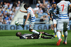 Queens Park Rangers' Joey Barton takes the ball from Newcastle United's Moussa Sissoko as he slips - Photo mandatory by-line: Dougie Allward/JMP - Mobile: 07966 386802 - 16/05/2015 - SPORT - football - London - Loftus Road - QPR v Newcastle United - Barclays Premier League
