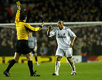 Photo: Chris Ratcliffe.<br /> Arsenal v Real Madrid. UEFA Champions League. 08/03/2006.<br /> Roberto Carlos does not agree with the yellow card given to him by referee Michel Lubos