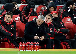 Manchester United manager Jose Mourinho in the dugout during the Premier League match at Anfield, Liverpool.