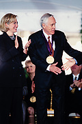 Actor Jason Robards is presented the National Medal of Arts by President Bill Clinton and First Lady Hillary Clinton during a ceremony on the South Lawn of the White House September 29, 1997 in Washington, DC.