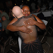 Zoe Balfour, left, hugs her friend and fellow dancer Sheila Dodd, both of Oakland, California after the conclusion of the same-sex ballroom dancing competition at the 2007 Eurogames at the Waagnatie hangar in Antwerp, Belgium on July 14, 2007. ..Over 3,000 LGBT athletes competed in 11 sports, including same-sex dance, during the 11th annual European gay sporting event. Same-sex ballroom is a growing sports that has been happening in Europe for over two decades.