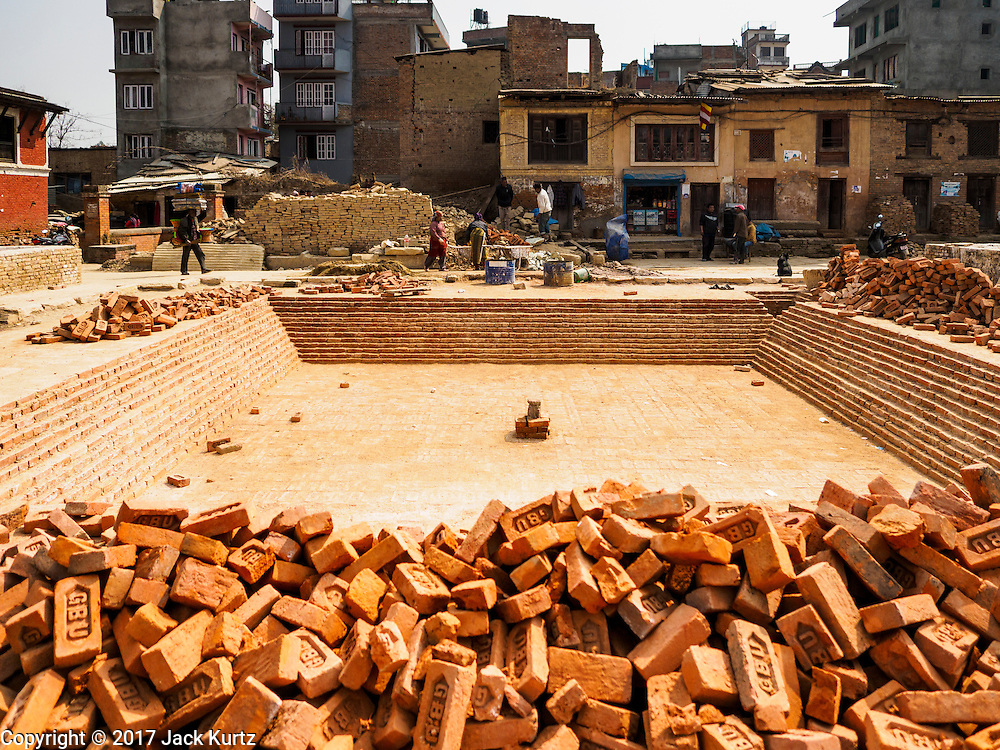 01 MARCH 2017 - BUNGAMATI, NEPAL: The site of  Rato Machindranath Temple, a 13th century Hindu temple destroyed in the 2015 earthquake. The temple was the most important structure in Bungamati and the center of the community life. Recovery seems to have barely begun nearly two years after the earthquake of 25 April 2015 that devastated Nepal. In some villages in the Kathmandu valley workers are working by hand to remove ruble and dig out destroyed buildings. About 9,000 people were killed and another 22,000 injured by the earthquake. The epicenter of the earthquake was east of the Gorka district.     PHOTO BY JACK KURTZ