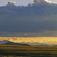 Sunset over Tobacco Root Mountains and hayfields near Bozeman.