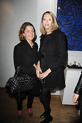 Left to right, VINNIE DAY and the HON.FLORA HESKETH at a private view of Henry Brudenell-Bruce's work held at 269 Portobello Road, London, W14 on 24th November 2009.
