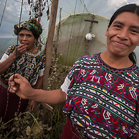 Indigenous community member Maria (R) with Petrona (L) in the community greenhouse. In the indigenous highlands of Nebaj, villagers have increased their food production by using greenhouses and irrigation. .
