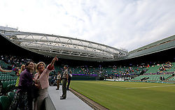 General view roof opening at the end of the day on No.1 court at The All England Lawn Tennis Club, London.