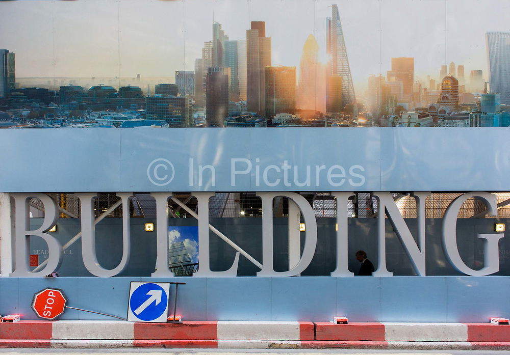 A large construction hoarding in the City of London, the  Square Mile, the capital's historic financial district. The illustration is located beneath a future office development of the Leadenhall Building by the Brookfield Multiplex construction company at 100 Bishopsgate in the financial district City of London. 100 Bishopsgate is a 40-storey commercial development, offering highly efficient and flexible floor space to meet the current and future demands of financial, insurance and legal occupiers. Located in the heart of the City of London, the development is in close proximity to Bank and Liverpool Street station commuter hubs.