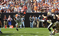 MORNING JOURNAL/DAVID RICHARD.Cleveland's Leigh Bodden, left, tries to block one of John Carney's four field goals yesterday for New Orleans.