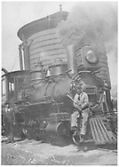 """RGS 2-8-0 #12 at water tank with engineer and fireman posing for the photographer.<br /> RGS    <br /> In book """"Rio Grande Southern, The: An Ultimate Pictorial Study"""" page 185"""