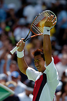 MELBOURNE, AUSTRALIA - JANUARY 23:  Paradorn Srichaphan of Thailand celebrates his victory during day five of the Australian Open January 23, 2004 in Melbourne, Australia. (Photo by Lars Mueller/Sportsbeat) *** Local Caption *** -