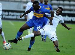 Cape Town 18-02-24 Cape Town City Nana AkosahBempah attacking as Wits midfielder Buhle Mkhanazi  trying to defender in the PSL Game In Athlone Staduim Pictures Ayanda Ndamane African news agency/ANA