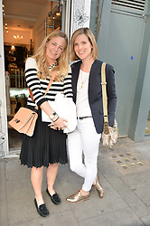 Left to right, ASTRID HARBORD and LIZZY PELLY at a party to launch Biscuiteers Fashion Biscuit Collection inspired by Alice Naylor-Leyland's wardrobe held at Biscuiteers, 194 Kensington Park Road, London W11 on 23rd June 2015.