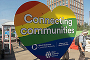 West Midland Combined Authority rainbow heart sticker Connecting Communities at a transport hub in the UK City of Culture 2021 on 23rd June 2021 in Coventry, United Kingdom. The UK City of Culture is a designation given to a city in the United Kingdom for a period of one year. The aim of the initiative, which is administered by the Department for Digital, Culture, Media and Sport. Coventry is a city which is under a large scale and current regeneration.