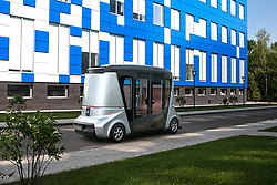 June 26, 2017 - Russia - June 26, 2017. - Russia. Far Eastern Federal University (FEFU) and 'Bakulin motors Group' announced the signing of a cooperation agreement, in which planned tests of the first Russian unmanned buses 'MatrEshka'. One of the areas of cooperation will be the launch of a pilot bus route 'MatrEshka', which will run on the FEFU campus on island Russian. Preparatory work in the framework of this project will be held in June-August and the start of testing is scheduled for early September. 'MatrEshka' is a fully Autonomous transport, developed by SKOLKOVO residents. It allows you to carry passengers, cargo and can work as utility vehicles. The creators claim that drones are safer than traditional buses, as they eliminated the human factor leading to the accident, and artificial intelligence monitors technical condition of transport and if there are problems, immediately accountable to the owners. In picture: Russia's first unmanned bus 'MatrEshka' concept art. Photo: matreshka.ai (Credit Image: © Russian Look via ZUMA Wire)