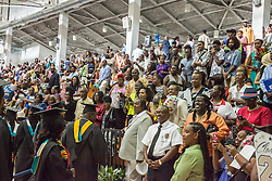 Family and friends cheer on the graduating class as they exit the commencement.  Fifty-first annual University of the Virgin Islands  Commencement Exercises.  UVI Sports & Fitness Center.  St. Thomas, VI.  14 May 2015.  © Aisha-Zakiya Boyd