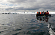 Eco-tourists in the pack-ice at 80-degrees north off Svalbard, Norway.