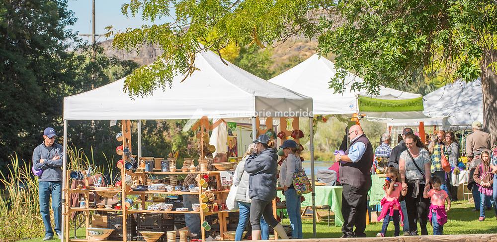 People touring the Thousand Springs Art Festival at Ritter Island near Hagerman, Idaho.