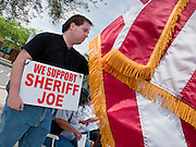 02 MAY 2009 -- PHOENIX, AZ: Phillip Quihuis (CQ) from Phoenix, demonstrates in support of Sheriff Joe Arpaio in front of the jail. About 1,500 people opposed to Sheriff Joe Arpaio's treatment of prisoners and his high profile crime suppression anti-undocumented raids, marched from his office to downtown Phoenix to the jail complexes on Durango in south Phoenix Saturday. There were about 50 pro-Arpaio counter demonstrators in front of the jail. Photo by Jack Kurtz