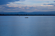 Fishing canoes in calm lake water Polonnaruwa, North Central Province, Sri Lanka, Asia