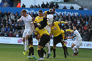Jose Holebas of Watford © tumbles as he clears from Alfie Mawson of Swansea city (l). Premier league match, Swansea city v Watford at the Liberty Stadium in Swansea, South Wales on Saturday 22nd October 2016.<br /> pic by  Andrew Orchard, Andrew Orchard sports photography.