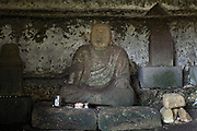 old and weathered Japanese Buddhist monument in a Yagura