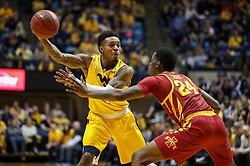 Feb 24, 2018; Morgantown, WV, USA; West Virginia Mountaineers guard Daxter Miles Jr. (4) passes the ball during the second half against the Iowa State Cyclones at WVU Coliseum. Mandatory Credit: Ben Queen-USA TODAY Sports
