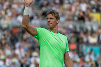 Tennis - 2019 Queen's Club Fever-Tree Championships - Day One, Monday<br /> <br /> Men's Singles, First Round: Cameron Norrie (GBR) Vs. Kevin Anderson (RSA)  <br /> <br /> Kevin Anderson (RSA) takes the fans applause after beating Cameron Norrie (GBR) on Centre Court.<br />  <br /> COLORSPORT/DANIEL BEARHAM