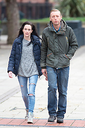 © Licensed to London News Pictures. 18/11/2015. Leeds UK. Kim Ager arrives at Leeds Magistrates Court with an unidentified man, She is charged with five count of theft from the children cancer unit at Leeds General Infirmary. The charges are in connection to the theft of laptop computers from the unit in July this year. Her son Callum was receiving treatment at the unit for an aggressive form of childhood cancer called Neuroblastoma. Photo credit: Andrew McCaren/LNP
