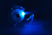Tape is pulled from a roll to show the property of triboluminescence. Triboluminescence is an optical phenomenon in which light is generated when asymmetrical crystalline bonds in a material are broken when that material is scratched, crushed, or rubbed.