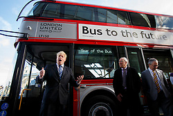 © licensed to London News Pictures. London, UK 27/01/2014. The Mayor of London, Boris Johnson launching the Year of the Bus from a specially painted silver New Routemaster bus at a photocall outside the City Hall. Photo credit: Tolga Akmen/LNP
