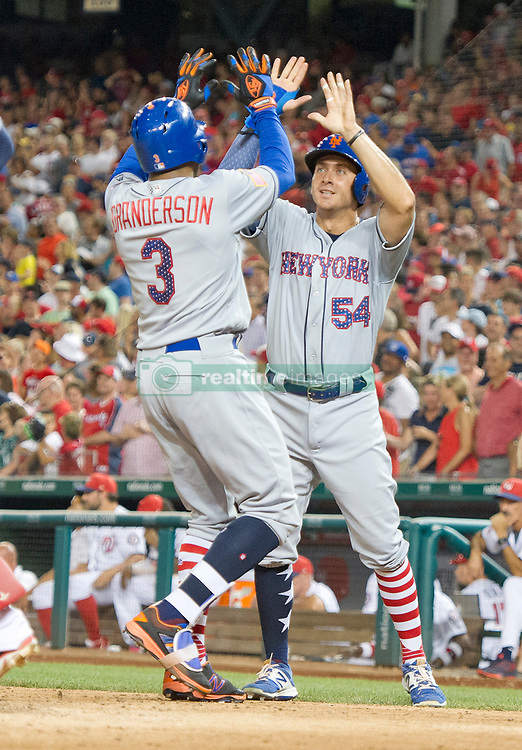 New York Mets left fielder Yoenis Cespedes (52) seemingly hits a ball off his foot in the first inning against the Washington Nationals at Nationals Park in Washington, D.C. on Monday, July 3, 2017. It was scored as a fair ball for a single. 03 Jul 2017 Pictured: New York Mets center fielder Curtis Granderson (3) is congratulated by first baseman T.J. Rivera (54) after they both scored to tie the game on Grandson's home run in the top of the ninth inning against the Washington Nationals at Nationals Park in Washington, D.C. on Monday, July 3, 2017. The Nationals won the game 3 - 2. Credit: Ron Sachs / CNP (RESTRICTION: NO New York or New Jersey Newspapers or newspapers within a 75 mile radius of New York City). Photo credit: Ron Sachs - CNP / MEGA TheMegaAgency.com +1 888 505 6342