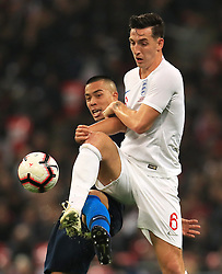 USA's Bobby Wood (left) and England's Lewis Dunk battle for the ball during the International Friendly at Wembley Stadium, London. PRESS ASSOCIATION Photo. Picture date: Thursday November 15, 2018. See PA story SOCCER England. Photo credit should read: Mike Egerton/PA Wire. RESTRICTIONS: Use subject to FA restrictions. Editorial use only. Commercial use only with prior written consent of the FA. No editing except cropping.
