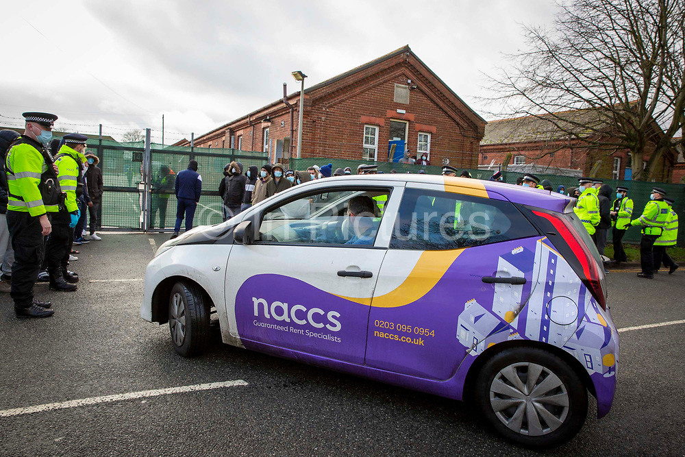 The NACCS Nationwide Accommodation Services Ltd management team arrive back at Napier Barracks to a peaceful protest by asylum seekers who are currently being held there in awful conditions on the 12th of January 2021 in Folestone, United Kingdom. Over 400 asylum seekers are being kept at Napier Barracks in unsuitable, cold accommodation that is managed by NACCS a property management company used by the UK Boarder Agency. Asylum seekers are experiencing mental health issues as well as being vulnerable to health conditions including COVID-19.