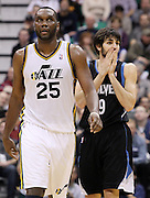 Minnesota Timberwolves guard Ricky Rubio of Spain (9) reacts after being charged with a foul on a rebound attempt with Utah Jazz center Al Jefferson (25) during the second half of an NBA basketball game, Saturday, Jan. 21, 2012, in Salt Lake City. The Jazz defeated the Timberwolves 108-98.(AP Photo/Colin E Braley)