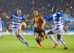 Wolves Diogo Jota takes the ball past Reading's David Edwards during the Sky Bet Championship match at the Madejski Stadium, Reading.