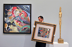 """© Licensed to London News Pictures. 15/06/2017. London, UK. (L to R) """"Bild mit weissen Linien"""", 1913, by Wassily Kandinsky (estimate on request), """"Femme et oiseaux"""", 1940, by Joan Miró (estimate on request) and """"Grande figure"""", 1947, by Alberto Giacometti (estimate GBP15-25m).  Preview of Impressionist and Modern art sale, which will take place at Sotheby's New Bond Street on 21 June.  Photo credit : Stephen Chung/LNP"""