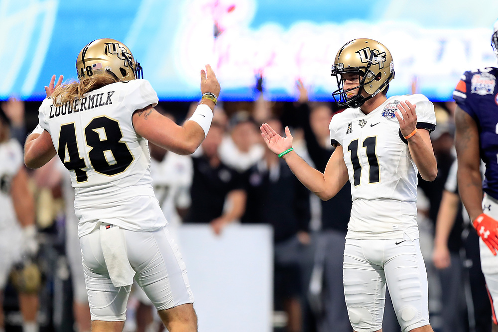 UCF Knights place kicker Matthew Wright (11) celebrates a field goal with punter Mac Loudermilk (48) during the 2018 Chick-fil-A Peach Bowl NCAA football game against the Auburn Tigers on Monday, January 1, 2018 in Atlanta. (Paul Abell / Abell Images for the Chick-fil-A Peach Bowl)