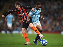 Shakhtar Donetsk's Mykola Matviyenko (left) and Manchester City's Raheem Sterling battle for the ball