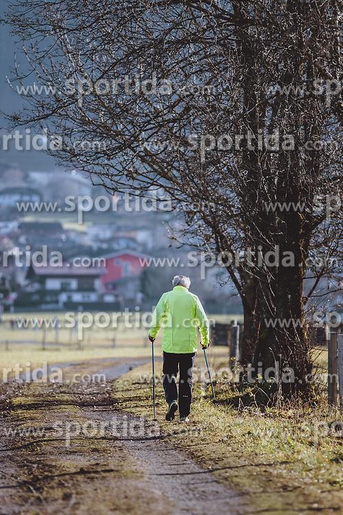 THEMENBILD - ein älterer Mann mit Nordic Walking Stöcke beim spazieren gehen, aufgenommen am 17. Novemeber 2020 in Kaprun, Österreich // an elderly man with Nordic Walking poles going for a walk, Kaprun, Austria on 2020/11/17. EXPA Pictures © 2020, PhotoCredit: EXPA/ JFK