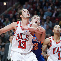 17 December 2009: New York Knicks center David Lee vies with Chicago Bulls center Joakim Noah for a rebound next to Chicago Bulls guard Derrick Rose during the Chicago Bulls 98-89 victory over the New York Knicks at the United Center, in Chicago, Illinois, USA.