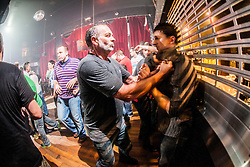 Students take part in an exercise. IKMS 'In The Club' seminar with KMG Global Team Instructor and Expert Level 5, Tommy Blom, at the Buff Club in Glasgow's City Centre. Bringing Krav Maga training out with the confines of the gym into a real nightclub/bar.<br /> © Michael Schofield.