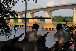 Men spend time in the shade on the newly developed riverbank near the bridge over the Mekong River, Kampong Cham town, Kampong Cham Province, Cambodia.