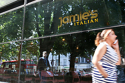 © Licensed to London News Pictures. 21/05/2019. London, UK. A woman walks past the Jamie's Italian in Islington, north London as Jamie Oliver's chain restaurants goes into administration leaving more than 1,000 jobs at risk. Photo credit: Dinendra Haria/LNP