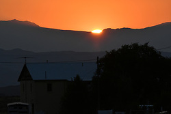 Sunset over the distant Mountains on the Road in Idaho, near Arco and Atomic City Route 26. After the Total Solar Eclipse 2017.