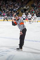 KELOWNA, CANADA - JANUARY 21: Referee Ryan Benbow makes a call to the Portland Winterhawks against the Kelowna Rockets on January 21, 2017 at Prospera Place in Kelowna, British Columbia, Canada.  (Photo by Marissa Baecker/Shoot the Breeze)  *** Local Caption ***