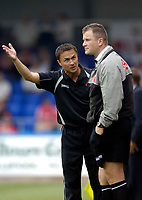 Photo: Jed Wee.<br />Hartlepool United v Swindon Town. Coca Cola League 2.<br />05/08/2006.<br /><br />Swindon manager Dennis Wise (L) remonstrates with fourth official R A Salt.