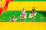 "01 SEPTEMBER 2011 - ST. PAUL, MN:  People ride the Giant Slide at the Minnesota State Fair. The Minnesota State Fair is one of the largest state fairs in the United States. It's called ""the Great Minnesota Get Together"" and includes numerous agricultural exhibits, a vast midway with rides and games, horse shows and rodeos. Nearly two million people a year visit the fair, which is located in St. Paul.  PHOTO BY JACK KURTZ"