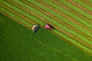 Top down shot of farmer bringing in a crop from his field in rural Wisconsin